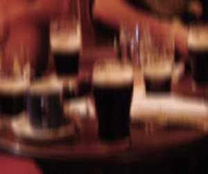 blurry picture of pints on a table in an Irish pub