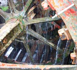 a close-up of the water wheel outside of locke's distillery in kilbeggan