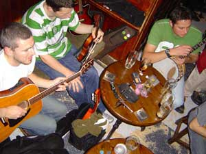 musicians gathered around the table at a traditional Irish session in Sean's Bar, Athlone